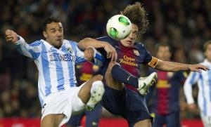 El Barça va empatar ahir al Camp Nou contra el Málaga i haurà de resoldre l'eliminatòria al partit de tornada